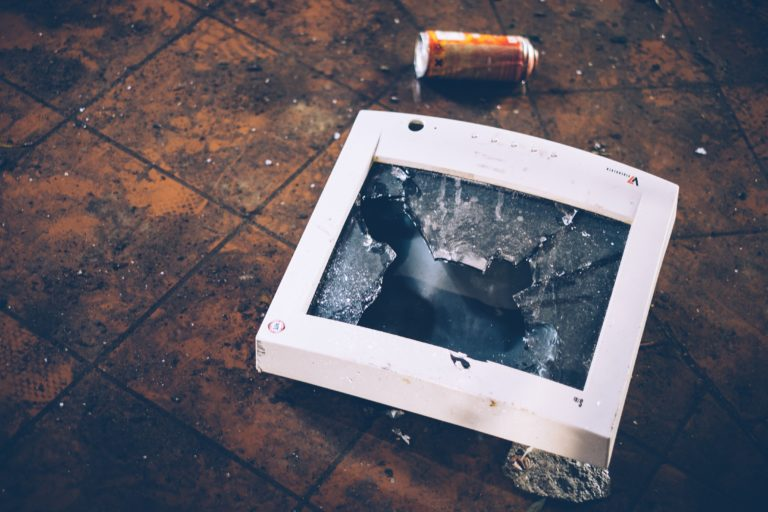 A smashed hospital computer monitor on the ground as a result of workplace violence