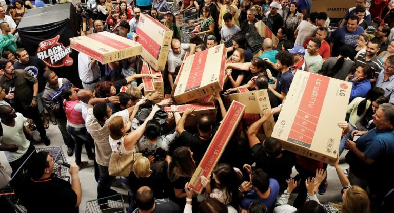 masses of people fighting over packages on the night of black friday