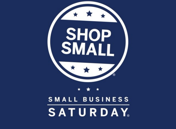"""A small business saturday logo with an icon writing """"shop small"""""""