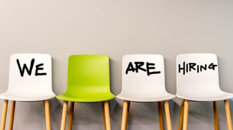 4 chairs lined up that spell we are hiring for a business development specialist position at UASC